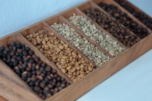 Level of roasted coffee beans on wood box, selective focus